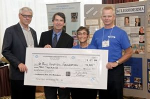 Rosanne and David presenting a cheque